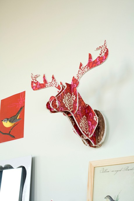 Make a deer head out of foam and scrapbook paper.